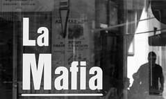 andalucia: spanish mafia (gregjack!) Tags: spain andalucia seville sevilla reflection lamafia dof glass window people man bw blackandwhite mono