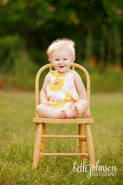 baby girl in antique yellow chair