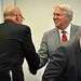 Greater Raleigh Chamber CEO Harvey Schmitt greets Chancellor Randy Woodson.