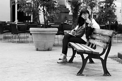"""hm, is he taking my photograph??"" (patrickbraun.net) Tags: street analog asian frankfurtmain olympusom4ti zuiko85mmf20 kodakprofessionalplusx125"
