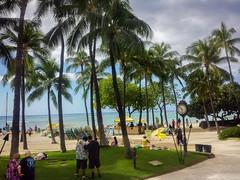 Waikiki Beach, visitors and dramatic sky (Victor Wong (sfe-co2)) Tags: green public city avenue tropical environment usa warm destination pleasant relaxed tourists hawaii waikiki oahu honolulu kalakaua dramatic sky outdoor plant tree palm