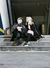 Stairway (Vorona Photography) Tags: city urban usa white black guy kitchen stockings girl leather america washington interesting shoes couple downtown angle state pacific image boots cigarette united relaxing rail railway gritty smoking stairway jeans jacket cap photograph local nightlife tacoma states knee avenue saddle hellskitchen hells highs