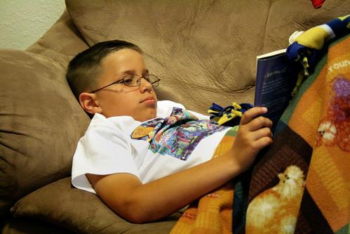 Jack reads for his Summer Reading Program.