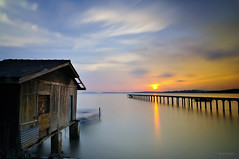in between (sirman88) Tags: ocean longexposure cloud seascape motion beach boat interestingness jetty pd malaysia slowshutter lightning pointing pantai sunser portdickson waterscape fbe pasirpanjang revisited ndfilter nd400 f19 2011 d90 fishermanvillage 13mm glorioussunset negerisembilan cokingnd8 tokina1116 azmanrahman sirman88 forbetterexposure
