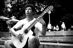 diego idarraga (kristine-va) Tags: life street people blackandwhite bw musician music canon photography concentration guitar live candid performance sydney documentary free acoustic classical strings local vignette guitarist 500d blackwhitephotos