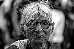 India (luca marella) Tags: travel portrait people bw woman india white black film face look analog glasses blackwhite luca teeth goggles pb bn e eyeglasses spectacles bianco nero marella marellaluca