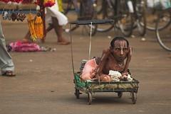 Mendicant on Grand Road, Puri (Shubh M Singh) Tags: road india man car festival trolley wheels grand holy asphalt yatra orissa chariot rath puri disability ratha mendicant 2011 rathyatra badadanda