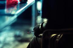 Taking A Break (Jon Siegel) Tags: man night lights nikon singapore hand arm f14 smoke 85mm smoking late nikkor smoker embers singaporean nikkor85mmf14