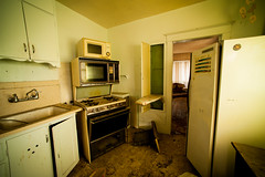 what's for dinner? (Sam Scholes) Tags: door urban house abandoned kitchen digital utah nikon oven sink urbandecay sandy dirty stove microwave d3 cupboards
