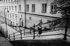 You've come a long way (Georgios Karamanis) Tags: street windows people bw woman white black tree sweden stockholm steps lamppost staircase workshop railing karamanis