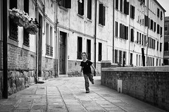 The Venetian Sprinter.. (Peter Levi) Tags: street city venice boy blackandwhite bw italy blancoynegro kid child streetphotography documentary running lad venezia venedig sprinter x100 boyrunning fujifilmx100 fujix100