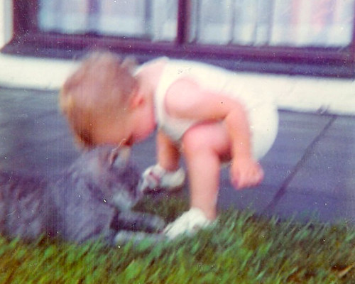 "Miriam (13 months) saying ""aaah"" to Tiddles, Nov 71"