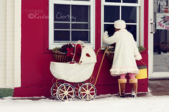 Window Shopping (Kimberly Chorney) Tags: christmas winter snow hat vintage mainstreet boots sweet naturallight gloves storefront littlegirl windowshopping hatboxes vintagewhitebuggy