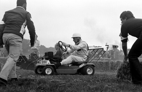 Stirling Moss competing at a lawn mower race.