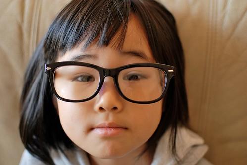 My girl wears black glasses