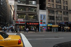 8th Avenue (Mattron) Tags: street nyc newyorkcity newyork building neon manhattan cab taxi midtown gothamist liquors streetscape curbed liquorstore 8thavenue 39thstreet