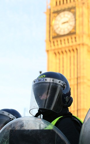 TSG Police Officer in Riot gear in front of Big Ben / Parliament, London