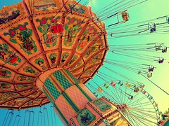 Somewhere Else (lostvestige) Tags: carnival blue sky sunlight colors beautiful fun photo scary pretty ride bright image circus pastel swings dream picture fair sparkle photograph ferriswheel flickraward flickraward5 nikoncoolpixp100