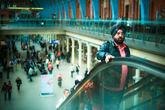 St Pancras (TGKW) Tags: portrait people man reflection london glass station st train asian candid escalator turban pancras 3298
