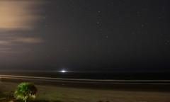 2011 Sky (J-a-x) Tags: ocean light sea sky usa water night clouds dark stars florida space horizon newyear clear newyearseve atlanticocean ponceinlet 2011 efs18200mmf3556is