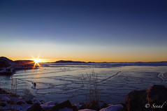 Icey sea (Senad_D) Tags: blue light sea sky orange white snow ice water crackling sweden horizon gradient lysekil