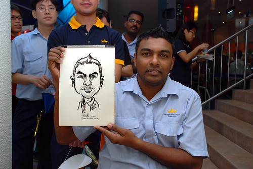 Caricature live sketching for BAT White Christmas Party 2010 - 6
