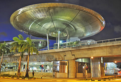Looks like a flying saucer is about to land at a glimpse... (williamcho) Tags: travel architecture train subway singapore asia transport platform terminal exhibition ufo tropical bluehour flyingsaucer mrt futuristic coconuttrees tanahmerah singaporeexpo imagesofsingapore flickraward expomrt flickrestrellas movingarchitecture nikonflickraward williamcho flyingsauces flickrtravelaward singaporeimagesd300