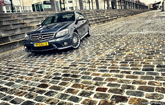 Mercedes-Benz C63 AMG (Niels de Jong) Tags: bw holland netherlands canon eos mercedes benz rotterdam shoot photoshoot c nederland sigma 63 mercedesbenz 18200 bens erasmusbrug amg vlaggen boompjes maasboulevard c63 nielsdejong 1000d ndjmedia