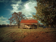 Remembering Better Times (evanleavitt) Tags: county wood roof red sky house abandoned home up rural ga vintage georgia tin darkness decay gorgeous south hill rusty jackson americana weathered shack on the a
