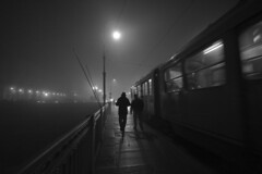 Foggy Turin (www.andreaalbertino.com) Tags: longexposure bridge winter people blackandwhite italy cold bus lamp fog night dark torino evening andrea perspective january streetphotography tram wideangle ponte nebbia turin piedmont lampioni gennaio highiso albertino 2011 sigma1020 canon50d mygearandmepremium mygearandmebronze mygearandmesilver mygearandmegold mygearandmeplatinum mygearandmediamond andreaalbertino artistoftheyearlevel4 galleryoffantasticshots