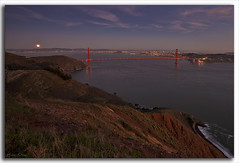 Out of the Gate..... (M. Shaw) Tags: ocean sanfrancisco california lighting longexposure bridge sunset sea cliff moon lighthouse reflection building history skyline night clouds canon lights cityscape historic goldengatebridge moonrise ferrybuilding bluehour coit 1635mmf28l canoneos5dmarkii mshaw 5dmark2