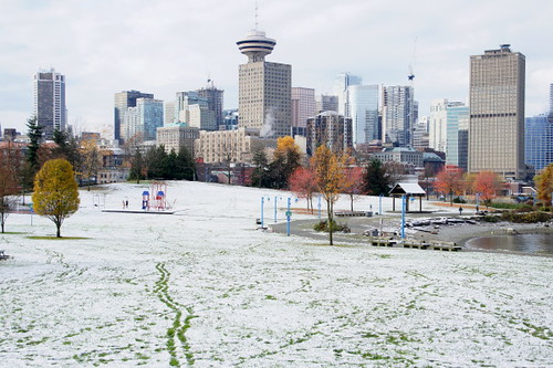 Dwntown Vancouver with Sears Tower Harbour Centre seen from Crab Park at the waterfront. Snow Falls on Autumn Leaves as Winter Comes Early for Vancouver on Nov. 20, 2010.