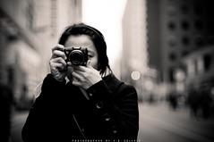 curiosity (Vincent D. Solihin) Tags: road street camera blackandwhite toronto ontario canada girl canon asian nikon bokeh pointandshoot 50mmf14 bloorstreet d300s