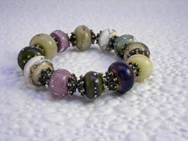 Stretchy bracelet with my Earthy Orbs beads and antique brass findings