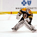 Tim Thomas plays the puck