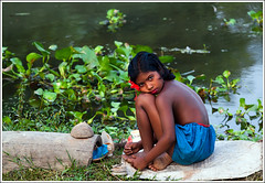Stolen moment [..Chuadanga, Bangladesh..] (Catch the dream) Tags: flower color water girl smile look rural children child play ripple shy moment bangladesh villagegirl shygirl girlchild waterhyacinth stolenmoment chuadanga alamdanga ailhash gettyimagesbangladeshq2