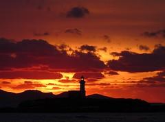 Tramonto al porto (Schano) Tags: sunset italy lighthouse nature faro photo mediterranean mediterraneo italia tramonto natura sicily sicilia paesaggio trapani photonature portoditrapani fz28 panasoniclumixfz28 farodellacolombaiatrapani