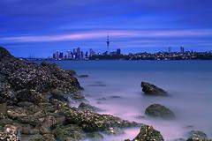 Auckland. New Zealand. (De Vil) Tags: ocean newzealand cloud seascape rocks shoreline auckland le northshore aotearoa chatswood waitemataharbour aucklandcbd nd110 canonef70200mmf28lisiiusm
