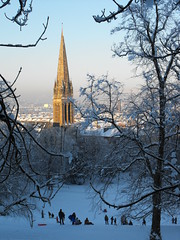 Sledging heaven (shotlandka) Tags: park trees winter plants snow tree ice church fun snowboarding scotland glasgow branches families spire queenspark finepix fujifilm sledge sledging    flickraward  s1000fd