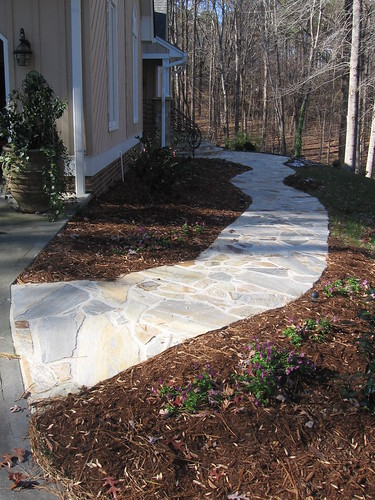 view of winding flagstone walkway on a home in southwest Raleigh, North Carolina