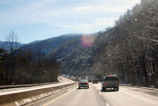 driving through sunny, snowy mountains