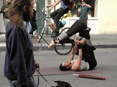 royal street acrobats (omoo) Tags: black feet girl tattoo la hands louisiana muscular neworleans saturday streetscene tights bicycles entertainment nola acrobats royalstreet tallbicycle beardedmanwithdog