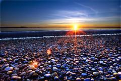 sun flares on rocks