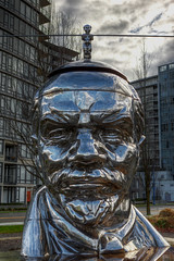 Miss Mao Trying to Poise Herself at the Top of Lenin's Head (gordeau) Tags: lenin sculpture metal big stainlesssteel head political small large communism gordon mao balancing balanced ashby controversial gao thechallengefactory gordeau