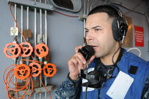 USS Ronald Reagan Sailor communicates info during exercise.