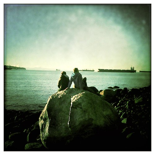 Couple on the rocks at 2nd Beach in Vancouver