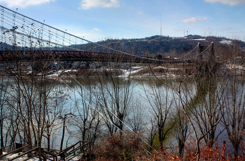 The Wheeling Suspension Bridge is a suspension bridge spanning the main channel of the Ohio River at Wheeling, West Virginia. It was the largest suspension