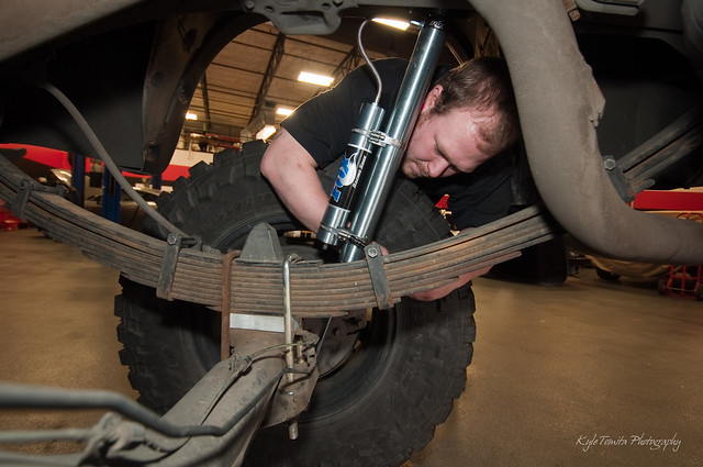 Gary Rayevich installing remote reservoir shocks on a Tundra