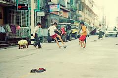 Street Kids 1 (Xiangk) Tags: street travel film sports kids 35mm fun fire focus asia minolta yangon burma soccer arcade suburbs myanmar manual srt101