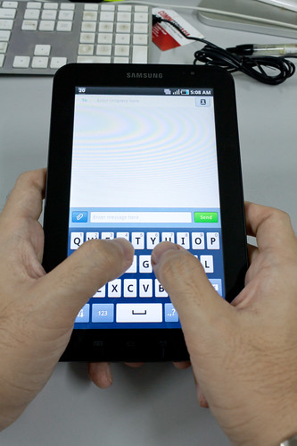 Samsung Galaxy Tab - two hands typing (vertical mode)
